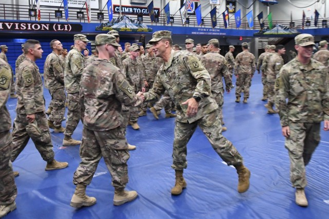 Maj. Gen. Brian Mennes, 10th Mountain Division (LI) and Fort Drum commander, shakes hands with 2nd Brigade Combat Team Soldiers returning to Fort Drum from a nine-month deployment on July 23. (Photo by Mike Strasser, Fort Drum Garrison Public Affairs)