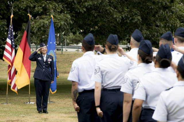 Airmen with the 86th Medical Squadron render a final salute to Air Force Col. Regina Paden during a change of command ceremony, July 19, where Paden relinquished command of the 86th MDS to Col. Sean Jersey.