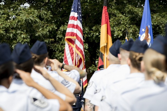 Airmen with the 86th Medical Squadron render a salute to the American colors during a change of command ceremony, July 19.