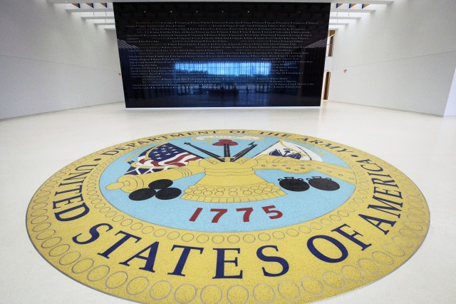 The lobby of the National Museum of the United States Army displays a 21-foot-diameter Department of the Army emblem on the floor. In the distance, a black granite wall listing every American campaign is displayed in the entrance lobby, July 25, 2019. Construction of the museum is ongoing, and doors are scheduled to open to the public in 2020.