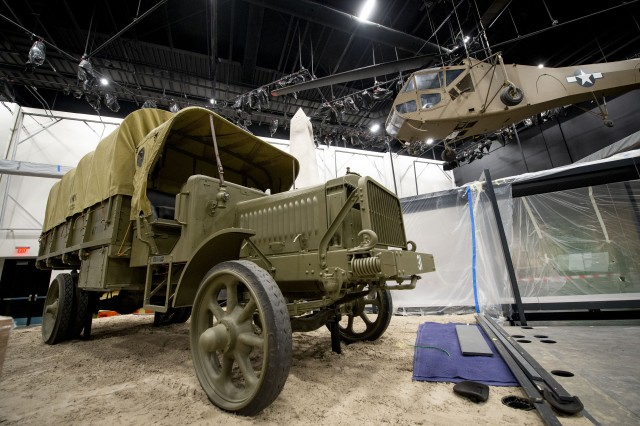 A Liberty Truck, pictured left, is displayed at the National Museum of the United States Army, July 25, 2019. It was the first truck developed as a dedicated military vehicle for the U.S. Army. The design was the result of a War Department project with private industry. Construction of the museum is ongoing, and doors are scheduled to open to the public in 2020.