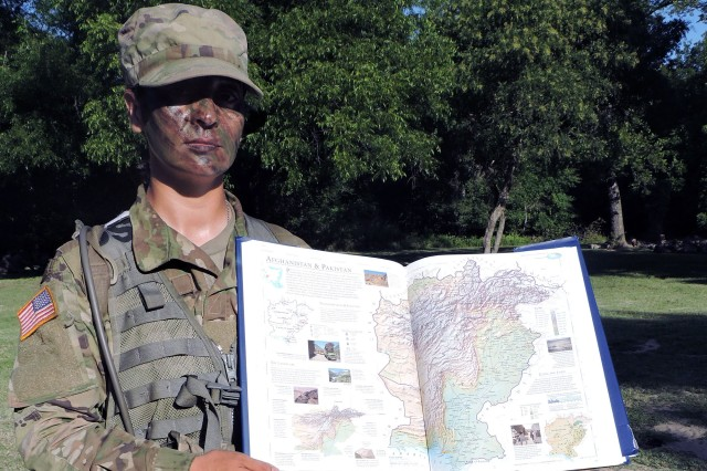Spc. Wahida Musleh, who's going through basic combat training at Fort Sill with D/1-31st FA, holds a map of her native country, Afghanistan. She was performing medical lanes training that morning, July 18, 2019.