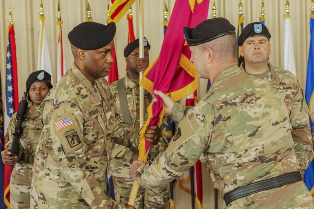 Col. Marvin Walker, left, receives Anniston Army Depot's guidon from Maj. Gen. Daniel Mitchell, the commanding general of Tank-automotive and Armaments Command July 25.