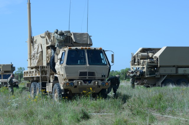 Soldiers of Bravo Battery, 3rd Battalion, 2nd Air Defense Artillery Regiment set up a Patriot communications and fire control center in the field at Fort Sill, Okla., June 18, 2019. The 3/2 ADA has undergone the recent Patriot modernization refit.