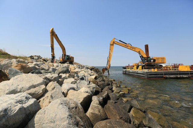 Large rocks are placed at the expansion site in April 2016 to armor dikes that will eventually contain dredged material from the approach channels to the Port of Baltimore. The expansion, authorized by Congress in 2007, allowed the project to expand beyond Poplar Island's 1846 footprint to create an additional 575 acres of dredged material containment and environmental restoration. Construction of the expansion containment cells is set to wrap-up in summer 2020. (U.S. Army photo by David Gray)