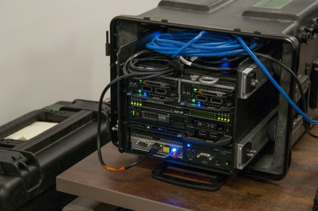 PEO EIS acquired for assessment this prototype defensive cyber system small enough to fit in an airplane's overhead storage compartment, enabling faster deployment and greater operational flexibility. (Photo by Cecilia Tueros, PEO EIS)