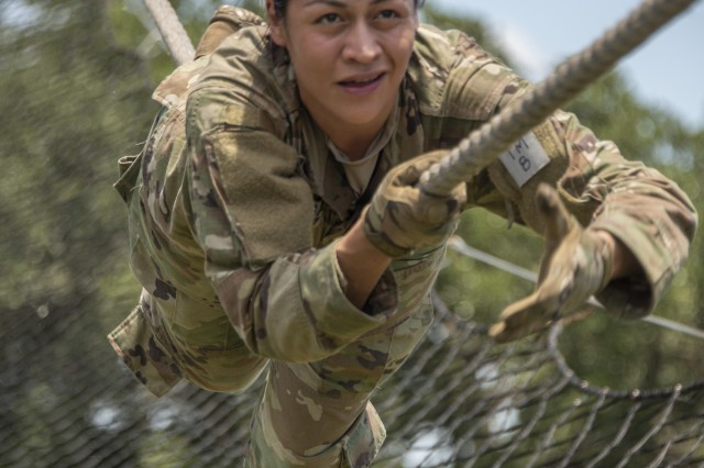 Sgt. Samantha Delgado, a radiology specialist from Brook Army Medical Center, tackles the obstacle course during the four-day Regional Health Command-Central Best Medic Competition on Camp Bullis. Delgado was part of the winning team that will compete in the Army Medicine Best Medic competition this fall.