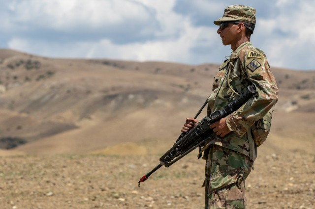 A Georgian Army National Guard Soldier from 178th Military Police Company await training to begin part of Agile Spirit 19 after unloading at a range in Vaziani Training Area near Tbilisi, Georgia July 28, 2019. Fourteen ally and partner nations are participating, while the co-leaders of the exercise, Georgia Defence Forces and U.S. Army Europe, create a realistic battleground with a variety of training exercises.