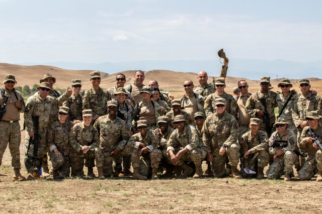 Georgian Army National Guard Soldiers from 178th Military Police Company and Georgian Defence Forces military police officers pose together for a group photo as they kick off training for exercise Agile Spirit 19 at Vaziani Training Area near Tbilisi, Georgia July 28, 2019. This is the beginning of the AgS19 exercise that involves live-fire exercises, tactical road marches, and medical training within a realistic battleground created by the co-leaders, Georgia Defence Forces and U.S. Army Europe.