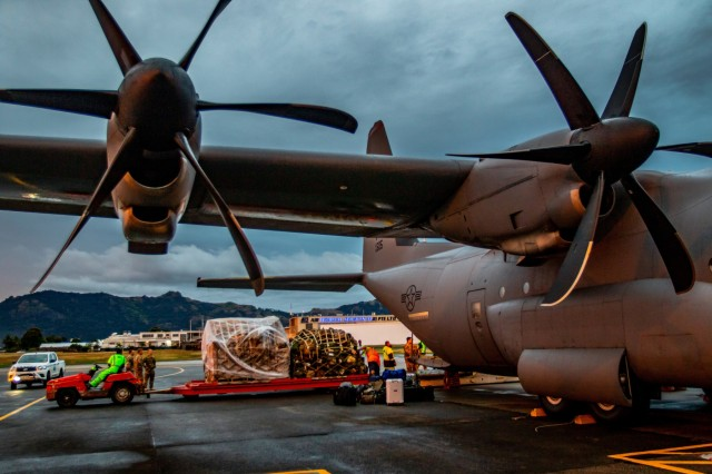 Airport workers unload a C-130 Hercules at the Nadi International Airport, July 27. The aircraft was one of two that brought by the U.S. Army, bringing Soldiers serving with the 1st Battalion, 27th Infantry Regiment, 2nd Brigade, 25th Infantry Brigade Combat Team, to stage and prepare for Exercise Cartwheel that will start on the 29th. Exercise Cartwheel is a bilateral military-to-military training exercise and is an opportunity to enhance professional relationships, military operations, and readiness between the U.S. Army and Fijian forces while strengthening security relations for a free and open Indo-Pacific.
