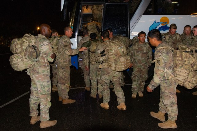 Capt. Douglas Richardson (left), who commands Bravo Company, 1st Battalion, 27th Infantry Regiment, 2nd Brigade, 25th Infantry Brigade Combat Team, watches as his Soldiers load on to a bus at the Nadi International Airport, July 27. The Soldiers will embed with The Republic of Fiji Military Forces in a field training exercise named Exercise Cartwheel. The FTX aims to enhance professional relationships, military operations, and readiness between the U.S. Army and Fijian forces while strengthening security relations for a free and open Indo-Pacific.