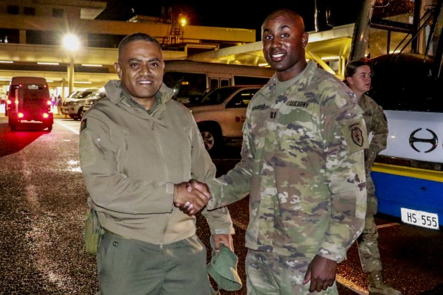 Fijian Army Maj. Mikaele Wara (left), who serves as D Company commander, 3rd Battalion Fiji Infantry Regiment, shakes hands with U.S. Capt. Douglas Richardson, who serves as commander of B Company, 1st Battalion, 27th Infantry Regiment, 2nd Brigade, 25th Infantry Brigade Combat Team at Nadi International Airport, July 27. The two commanders will be engaged in a bilateral field training exercise called Exercise Cartwheel, which will be conducted on the island of Vanua Levu, from July 29 - August 12. The military relationship between the U.S. and Fiji is strong and is based on mutual respect and cooperation. Combined bilateral training provides ready land forces capable of conducting full-spectrum multinational operations to prevent, mitigate and respond to transnational and regional threats.