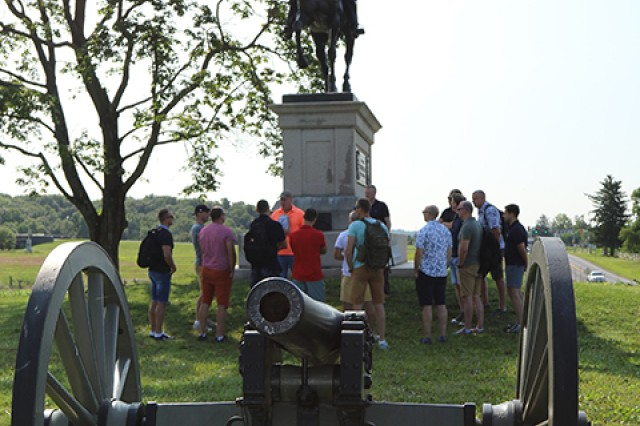 Leaders of the 28th Infantry Division and Lithuanian Land Forces Army gather near the Maj. Gen. John Reynolds monument at the Gettysburg battlefield on July 25, 2019. LLF soldiers were in Pennsylvania for week-long staff exchange.