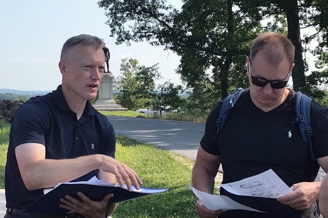 Maj. Robert Slate, 28th Infantry Division action officer for the staff exchange with Lithuanian Land Forces Army, discusses the Union position at Gettysburg with Lithuanian Land Forces Army Chief of Staff Col. Zilvinas Gaubys during a battlefield tour July 25, 2019.