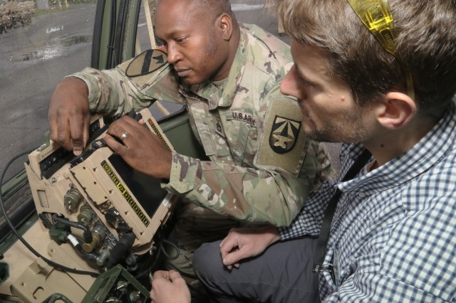 Sgt. 1st Class Edvar Chevalier and Ivan Couvillon demonstrate a prototype of the new Joint Battle Command-Platform installation kit for the Family of Medium Tactical Vehicles at Aberdeen Proving Ground, Md., in May 2019.