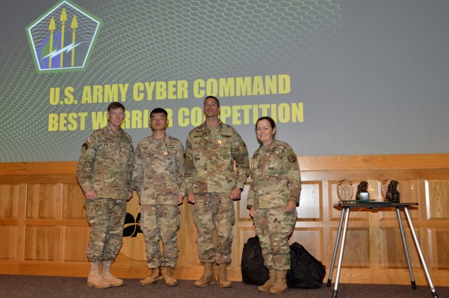2019 U.S. Army Cyber Command (ARCYBER) Best Warrior Competition NCO of the Year Sgt. Xiaohui Zhang (second from left) and Soldier of the Year Pfc. Roberto Sanchez (second from right) pose with ARCYBER commander Lt. Gen. Stephen Fogarty and ARCYBER senior enlisted leader Command Sgt. Maj. Sheryl Lyon, at the competition awards ceremony at Fort Belvoir, Va., July 26, 2019.