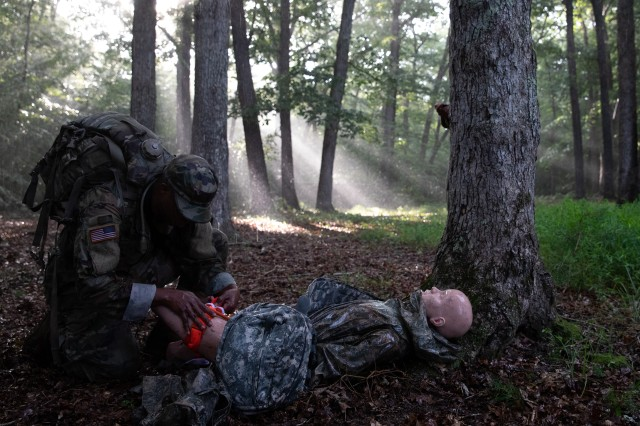 Spc. Keel Charles III of the 44th Expeditionary Signal Battalion provides medical aid to a simulated casualty during the U.S. Army Cyber Command (ARCYBER) Best Warrior Competition, at Marine Corps Base Quantico, Va., July 24, 2019. The top NCO and Soldier in the five-day ARCYBER competition go on to compete in the U.S. Army-level Best Warrior Competition.
