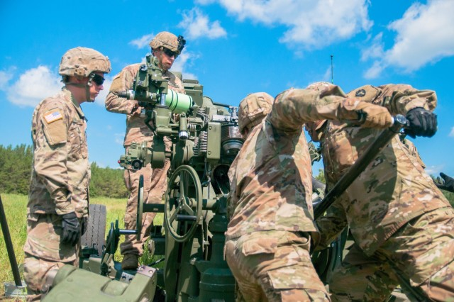 Soldiers assigned to the 426th Regiment (Field Artillery) Regional Training Institute (RTI) loads an M777 A2 Howitzer cannon with M1122 155-mm projectile during their culminating live-fire exercise (LFX) at Ft. McCoy, Wis., July 27, 2019.