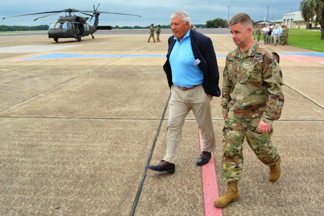 Maj. Gen. David J. Francis, Fort Rucker and USAACE commanding general, walks with retired Gen. Richard A. Cody, who visited Fort Rucker July 23-24 as chairman of the National Commission on Military Aviation Safety, at Cairns Army Airfield before an aerial tour of stagefields.