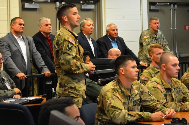 Members of the National Commission on Military Aviation Safety observe a student preflight brief in a classroom at Cairns.
