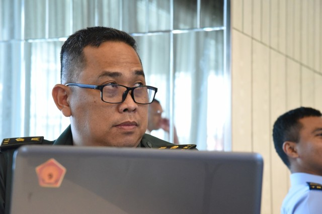 Tentara Nasional Indonesia Army Maj. Sakundira Parama listens to presentations during the 2019 Information System and Technology Exchange, July 23, 2019, Jakarta, Indonesia. This year's third annual ISTX falls under the Hawaii National Guard's State Partnership Program, and aims to share best practices, assist in cyber security doctrine development, and enhance the cyber security capabilities to effectively defend and protect critical cyber information infrastructure from malicious virus and cyber intrusion. (U.S. Army National Guard Photo by Staff Sgt. Katie Gray)