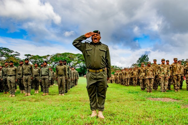 Fijian Maj. Mikaele Wara, who serves as the commander for the 3rd Battalion, Fiji Infantry Regiment, salutes and shouts commands to the U.S. and Fijian ranks behind him during the opening ceremony of Exercise Cartwheel 2019  in Labasa, Fiji, July 29. The events are bilateral exercises, which strengthen our nations' capabilities to respond to crisis situations. The US Army is committed to maintaining a long lasting relationship with our Fijian partners in the Pacific.