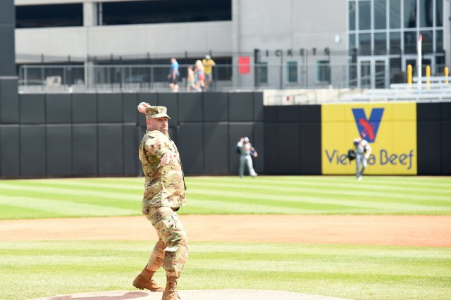 Army Reserve Col. Daniel Jaquint, assigned to the 85th U.S. Army Reserve Support Command headquarters, throws out a first pitch during the American Association of Independent Professional Baseball's Chicago Dogs baseball home game, July 28, 2019, at Impact Field in Rosemont, Illinois against the Cleburne Railroaders. Soldiers from the 85th USARSC attended there for pre-game activities to conduct a ceremonial first pitch and a presentation of colors. Jaquint, G3/Operations, was honored throwing in a first pitch and the 85th USARSC color guard team presented the Nation's colors during the playing of the National Anthem. Jaquint twice deployed across his three decades of service. Sgt. Maribel Meraz, color guard non-commissioned officer-in-charge, has been mobilized for two deployments across her 11 years of service in the Army Reserve. The 85th U.S Army Reserve Support Command's nine Brigade Support Elements, and 45 Army Reserve battalions, dispersed across 25 states, provide observer coach/trainer support to assist First Army with mobilization certification for deploying Army Reserve and National Guard units. (U.S. Army Reserve photo by Anthony L. Taylor)