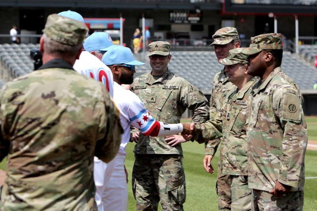 Army Reserve Soldiers assigned to the 85th U.S. Army Reserve Support Command headquarters meet players from the American Association of Independent Professional Baseball's Chicago Dogs baseball team, July 28, 2019, at Impact Field in Rosemont, Illinois during a home game there against the Cleburne Railroaders. Soldiers from the 85th USARSC attended there for pre-game activities to conduct a ceremonial first pitch and a presentation of colors. Col. Daniel Jaquint, G3/Operations, was honored throwing in a first pitch and the 85th USARSC color guard team presented the Nation's colors during the playing of the National Anthem. Jaquint twice deployed across his three decades of service. Sgt. Maribel Meraz, color guard non-commissioned officer-in-charge, has been mobilized for two deployments across her 11 years of service in the Army Reserve. The 85th U.S Army Reserve Support Command's nine Brigade Support Elements, and 45 Army Reserve battalions, dispersed across 25 states, provide observer coach/trainer support to assist First Army with mobilization certification for deploying Army Reserve and National Guard units. (U.S. Army Reserve photo by Anthony L. Taylor)
