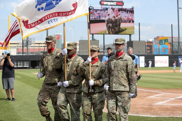 An Army Reserve color guard team, assigned to the 85th U.S. Army Reserve Support Command headquarters, present the Nation's Colors during the American Association of Independent Professional Baseball's Chicago Dogs baseball home game, July 28, 2019, at Impact Field in Rosemont, Illinois against the Cleburne Railroaders. Soldiers from the 85th USARSC attended there for pre-game activities to conduct a ceremonial first pitch and a presentation of colors. Col. Daniel Jaquint, G3/Operations, was honored throwing in a first pitch and the 85th USARSC color guard team presented the Nation's colors during the playing of the National Anthem. Jaquint twice deployed across his three decades of service. Sgt. Maribel Meraz, color guard non-commissioned officer-in-charge, has been mobilized for two deployments across her 11 years of service in the Army Reserve. The 85th U.S Army Reserve Support Command's nine Brigade Support Elements, and 45 Army Reserve battalions, dispersed across 25 states, provide observer coach/trainer support to assist First Army with mobilization certification for deploying Army Reserve and National Guard units. (U.S. Army Reserve photo by Anthony L. Taylor)