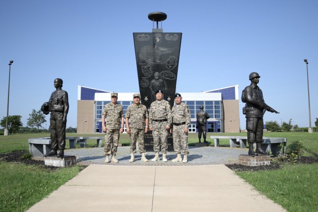 Senior leaders of the Kazakhstan Ground Forces pose in front of the 101st Airborne Division (Air Assault) headquarters Fort Campbell, Ky., July 25. The purpose of their visit was to observe and discuss best practices regarding the nature of command relationships, the roles and responsibilities of officers and senior noncommissioned officers on the brigade and battalion staff, the employment and sustainment of light infantry units in support of multinational operations with an anticipation of improving operations of their ground forces in Kazakhstan. (U.S. Army photo by: Staff Sgt. Michael Eaddy)