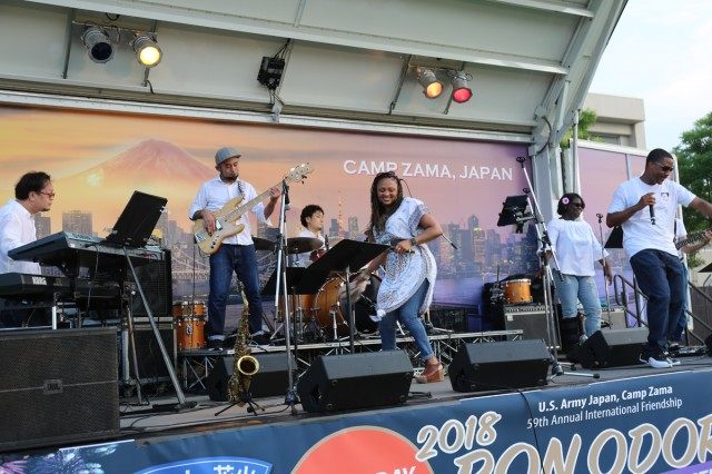 Soul 81 members entertain the crowd during the 59th annual Bon Odori Festival held Aug. 4, 2018, on Camp Zama, Japan. Since its inception in 1959, Camp Zama's Bon Odori Festival has been a way for the Army community in Japan to participate in and learn more about Japanese culture, and to share that experience with their host-nation neighbors. This year will mark the 60th anniversary of the Bon Odori Festival at Camp Zama.