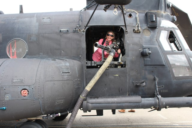 A member of Special Operations Forces-Civilian Leadership and Development Program enjoyed a tour aboard a MH47 at the U.S. Army Special Operations Command capabilities exercise during a two-day visit hosted by USASOC, June 10-11, 2019.  (Photo by U.S. Army Special Operations Command Public Affairs Office.)