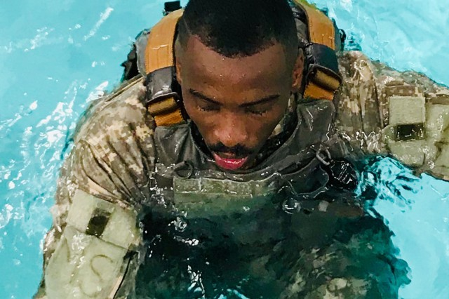 Spc. Mondeka Douei, catches his breath after completing the combat water survival proficiency portion of Blanchfield Army Community Hospital's Soldier of the Quarter Board. The Soldier of the Quarter Board was a rigorous two day competition that tested Soldiers in a variety of areas, including, tactical combat casualty care, hot and cold helicopter patient loads and hoist operations, day and night land navigation, written exam, essay, oral board, Army Combat Fitness Test, and Army warrior tasks. Douei was selected after competing with 14 other candidates from the hospital and outlying medical homes.