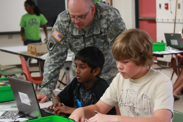 U.S. Army service members work with students during the C5ISR Center's annual STEM Summer Camp.