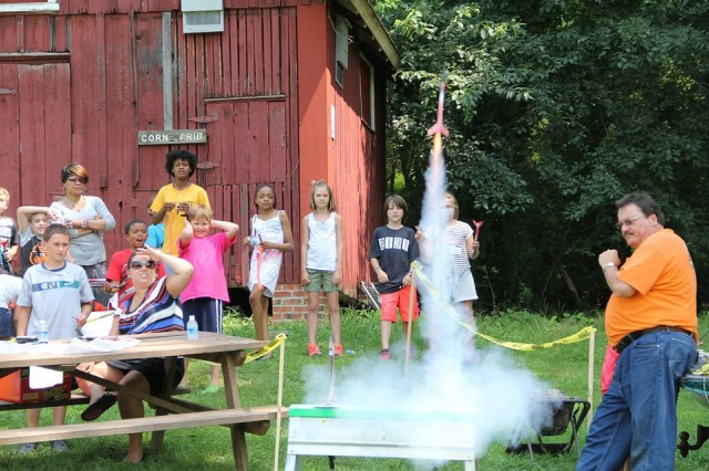 Students watch as a homemade rocket is launched during a session at STEM Summer Camp.
