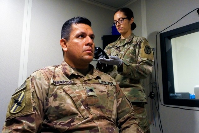 U.S. Army Medical Department Activity- Fort Stewart, Audiologist Capt. Marisa Ragonesi, conducts post-deployment hearing tests for the 48th Infantry Brigade Combat Team during their redeployment.