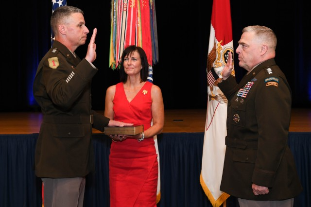 Gen. Joseph M. Martin, left, is sworn in as the Army's vice chief of staff at the Pentagon, Arlington, Va., July 26, 2019. He succeeds Gen. James C. McConville who served in the position since June 2017. McConville was confirmed by the Senate to succeed Gen. Mark A. Milley, pictured right, as the service's chief of staff.