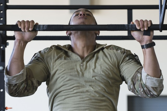 An Air Force Tactical Air Control Party Airman assigned to the 10th Air Support Operations Squadron, Fort Riley, Kan., performs pull-ups as part of a Tier II Operator Fitness Test during the 2019 Lightning Challenge at Joint Base Lewis-McChord July 29.