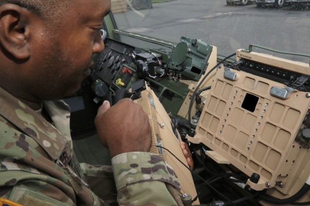 Sgt. 1st Class Edvar Chevalier demonstrates a prototype of the new Joint Battle Command-Platform installation kit for the Family of Medium Tactical Vehicles at Aberdeen Proving Ground, Md., in May 2019.