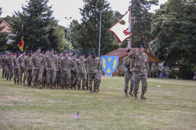Lt. Col. Karl Sondermann, commander, 21st Special Troops Battalion, 21st Theater Sustainment Command, and Soldiers salute the reviewing officer while conducting a pass in review during the 21st TSC Change of Command Ceremony, July 31, 2019 on Daenner Kaserne in Kaiserslautern, Germany. (U.S. Army photo by Pfc. Charles Thorman, 21st Theater Sustainment Command)