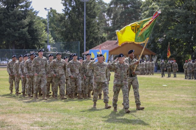 Col. Timothy McDonald, 18th Military Police Brigade commander, and Soldiers salute the reviewing officer, July 31, 2019, while conducting a pass in review during the 21st Theater Sustainment Command change of command ceremony on Daenner Kaserne in Kaiserslautern, Germany. Maj. Gen. Christopher O. Mohan assumed command of U.S. Army Europe's two-star sustainment command from Maj. Gen. Steven A. Shapiro, outgoing commander. (U.S. Army photo by Pfc. Charles Thorman, 21st Theater Sustainment Command)