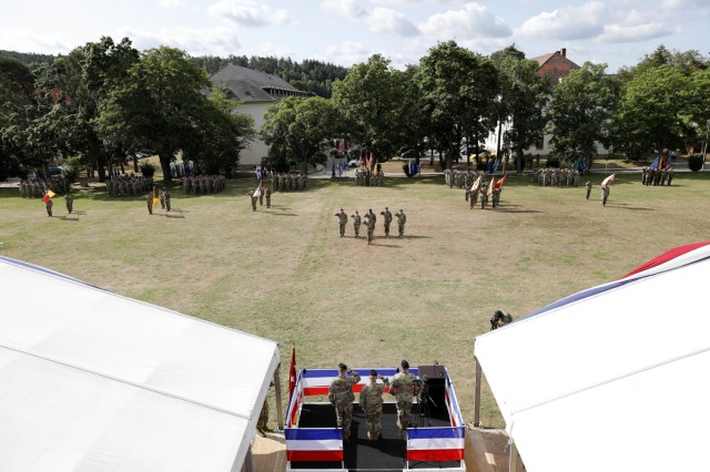 Soldiers from the 21st Theater Sustainment Command render honors during a salute battery for the 21st TSC change of command July 31, 2019 on Daenner Kaserne in Kaiserslautern, Germany. Maj. Gen. Steven A. Shapiro relinquished command to Maj. Gen. Christopher O. Mohan. Shapiro will continue his Army career in Rock Island, Illinois at the U.S. Army Sustainment Command. (U.S. Army photo by Sgt. Benjamin Northcutt, 21st Theater Sustainment Command.)