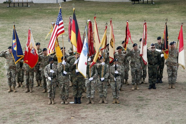 The 21st Theater Sustainment Command brigade colors mass in a single formation behind the 21st TSC Color Guard during the 21st TSC change of command ceremony July 31, 2019  on Daenner Kaserne in Kaiserslautern, Germany.Maj. Gen. Steven A. Shapiro, outgoing commanding general of 21st TSC, relinquished command to Maj. Gen. Christopher O. Mohan, incoming commanding general 21st TSC. Shapiro will continue his Army career in Rock Island, Illinois at the U.S. Army Sustainment Command.(U.S. Army photo by Sgt. Benjamin Northcutt, 21st Theater Command.)