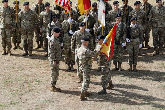 Maj. Gen. Steven Shapiro, outgoing commanding general 21st Theater Sustainment Command, passes the 21st TSC colors to Lt. Gen. Christopher Cavoli, commanding general U.S. Army Europe, during the 21st TSC change of command ceremony July 31, 2019 on Daenner Kaserne in Kaiserslautern, Germany. The passing of the colors signifies the return of responsibility of which he was entrusted in and to ensure the unit is never without officer leadership.(U.S. Army photo by Sgt. Benjamin Northcutt, 21st Theater Sustainment Command.)
