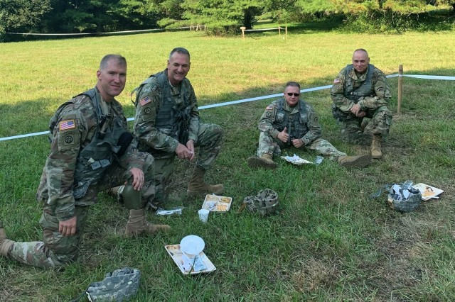 Leaders of the 642nd Aviation Support Battalion and the 42nd Combat Aviation Brigade sample food prepared by the 642nd cooks as part of the Philip A. Connelly Award Program on July 27, 2019, at Fort Indiantown Gap, Pennsylvania. Enjoying the meal are, from left, 642nd Battalion Commander Lt. Col. Shawn Hatch, 42nd Brigade Commander Lt. Col. Michael Charnley, 42nd Command Sgt. Maj. Mark Wilson, and 642nd Command Sgt. Maj. Robert Ravert.