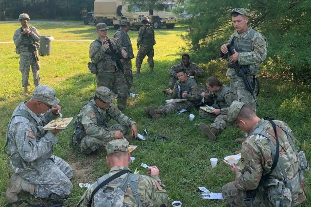 Soldiers assigned to Headquarters Company 642nd Aviation Support Battalion, New York Army National Guard, are enjoying the dinner meal during the field training exercise on July 27th as part of their Annual Training at Fort Indian Town Gap, PA.