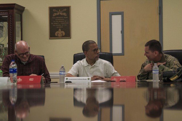 (Left to right) Mr. Billy Sutey member of the House Armed Services Subcommittee on tactical Air and Land Forces and Anthony Brown, United States Representative, 4th District Maryland and Col. Ralph Overland, commander of the 3d Cavalry Regiment discuss the regiments equipment, personnel, capabilities and shortfalls during a roundtable discussion, July 31, 2019. (U.S Army photo by Staff Sgt. Justin Geiger, 3d Cavalry Regiment)