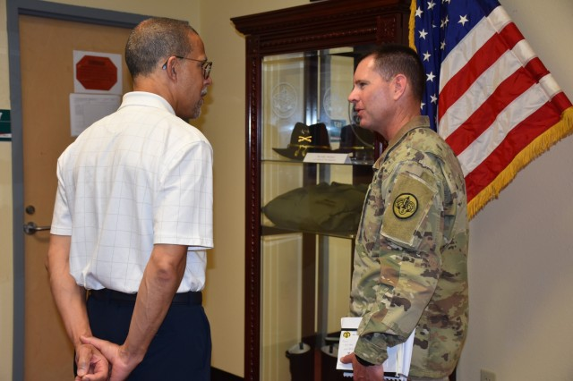 (Right to left) Col. Ralph Overland, commander of the 3d Cavalry Regiment gives Anthony Brown, United States Representative, 4th District Maryland a tour of the regimental headquarters and a brief overview of the Brave Rifles history, prior to their roundtable discussion, July 31, 2019. (U.S. Army photo by Capt. Jo Nederhoed, 3d Cavalry Regiment)
