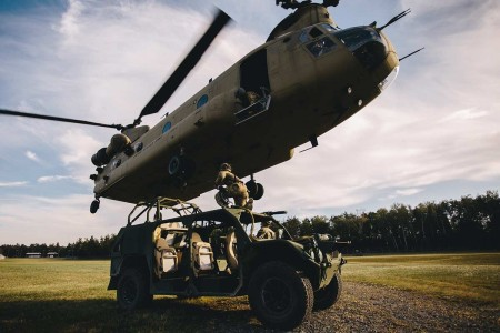 U.S. Army paratroopers with the 173rd Airborne Brigade, sling load a U.S. Army Ground Mobility Vehicle to a CH-47 Chinook in preparation for air assaulting into Hohenfels Training Area, Germany, during Exercise Saber Screen 19, July 22, 2019.