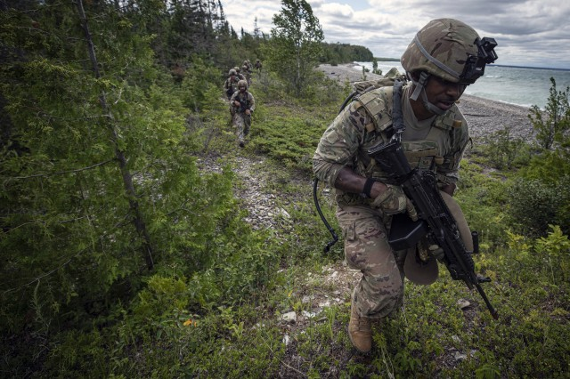 A U.S. Air Force Airman from the Georgia Air National Guard's 116th Security Forces Squadron leads the way for Latvian joint terminal attack controllers and fellow Airmen while hiking alongside Lake Huron on a training mission during Northern Strike 19 in Rogers City, Mich., July 30, 2019. Northern Strike 19 is a National Guard Bureau-sponsored exercise uniting service members from more than 20 states, multiple service branches, and numerous coalition countries during the last two weeks of July 2019 at the Camp Grayling Joint Maneuver Training Center and the Alpena Combat Readiness Training Center, both located in northern Michigan and operated by the Michigan National Guard. The accredited Joint National Training Capability exercise demonstrates the Michigan National Guard's ability to provide accessibly, readiness-building opportunities for military units from all service branches to achieve and sustain proficiency in conducting mission command, air, sea, and ground maneuver integration, together with the synchronization of fires in a joint, multinational, decisive action environment.